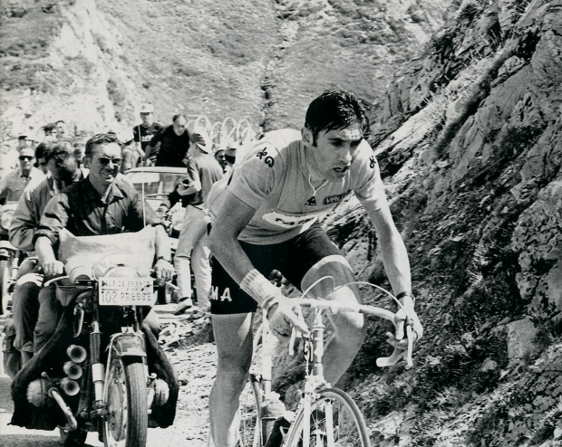 The Prophet solos in the mountains wearing the Yellow Jersey.