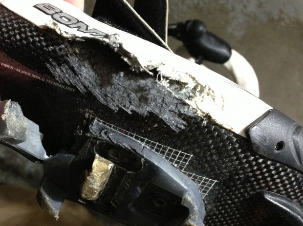Scrapped carbon and a torn cleat serve as reminders of a sudden crash.